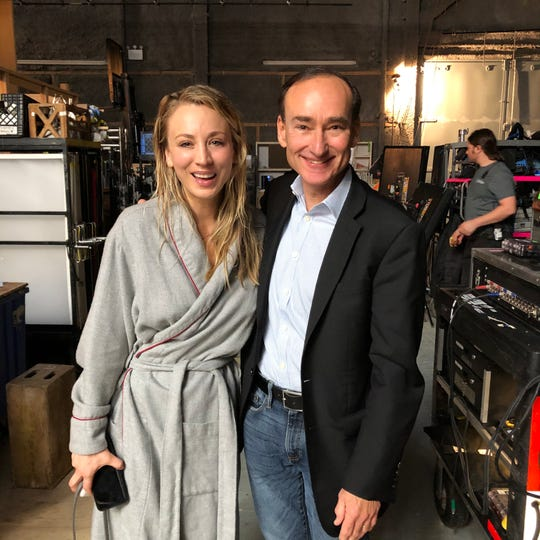 """Vermont author Chris Bohjalian poses with actress/producer Kaley Cuoco on the set of """"The Flight Attendant,"""" a television series based on Bohjalian's novel."""