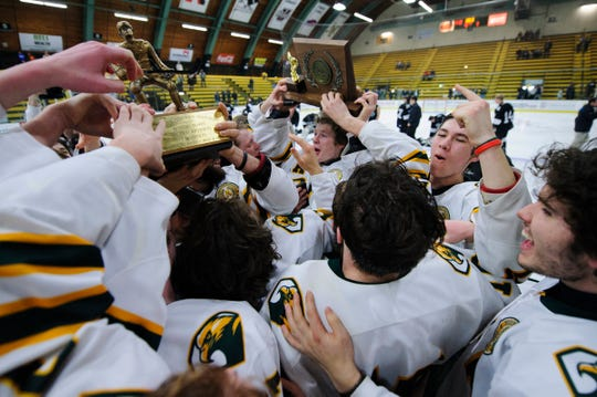 BFA celebrates the championship during the DI boys hockey championship game between the Stowe Raiders and the BFA St. Albans Bobwhites at Gutterson Field House on Wednesday night March 11, 2020 in Burlington, Vermont.