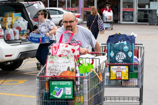 People buy food and supplies at the HEB on Saratoga in Corpus Christi on Thursday, March 12, 2020.
