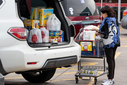 A women loads supplies in to her vehicle outside the HEB on Saratoga in Corpus Christi on Thursday, March 12, 2020.