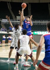 Zane Trace senior Cam Evans shoots over Harvest Prep to score during a  Division III Regional Semifinal game at Ohio University's Convocation center on March 11, 2020. Evans broke the Zane Trace all-time scoring record with a total of 1,652 points.