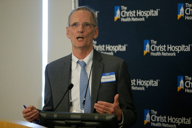 Dr. Rick Lofgren gives an update on behalf of UC Health, during a press conference to give an update on the region's hospital response at Christ Hospital in the Mount Auburn neighborhood of Cincinnati on Thursday, March 12, 2020. UC Health is cutting pay for some of its workers.
