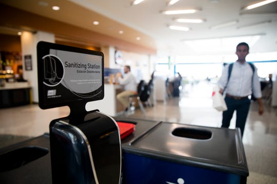 A view of a hand sanitizing station in the food court area of Cincinnati/Northern Kentucky International Airport on Thursday, March 12, 2020, in Hebron, Ky.