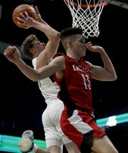 Lakota East High School's Kaden Fuhrmann goes up for the basket as La Salle's Derek Eddings flies past during their Division I regional semifinal boys basketball game at the Cintas Center in Cincinnati Wednesday, March 11, 2020.