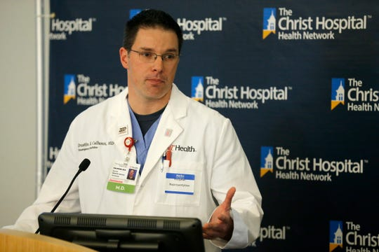 Dr. Dustin Calhoun of UC Health gives a briefing during a press conference to give an update on the region's hospital response at Christ Hospital in the Mount Auburn neighborhood of Cincinnati on Thursday, March 12, 2020.