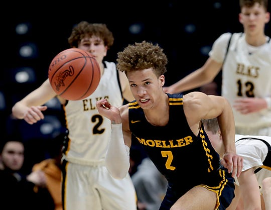Moeller High School guard Max Land chases a loose ball against Centerville during their Division I regional semifinal boys basketball game at the Cintas Center in Cincinnati Wednesday, March 11, 2020.