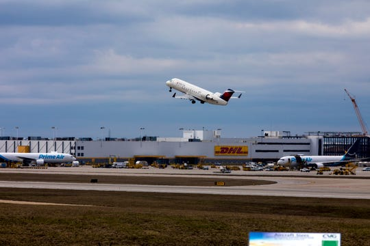 A delta flight takes off from Cincinnati/Northern Kentucky International Airport on Thursday, March 12, 2020, in Hebron, Ky.