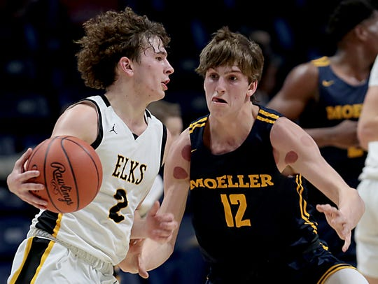 Moeller High School guard Will McCracken covers Centerville guard Drew Thompson during their Division I regional semifinal boys basketball game at the Cintas Center in Cincinnati Wednesday, March 11, 2020.
