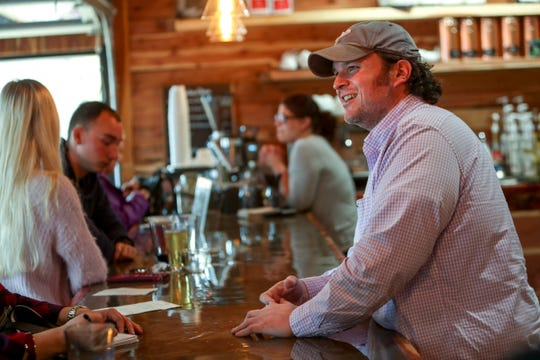 Hunter Stapp interacts with customers in the first week of business at The Thirsty Goat in Clarksville, Tenn., on Wednesday, March 11, 2020.