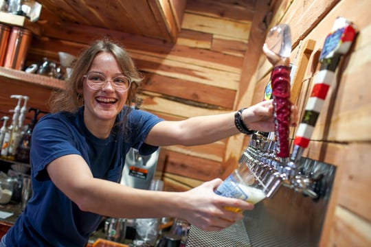 Rebecca Thomack pours a beer almost tapped out at The Thirsty Goat in Clarksville, Tenn., on Wednesday, March 11, 2020.