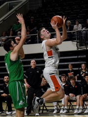 Ridgewood senior Trey Stoffer (right) dodges Fairland defender junior Jacob Polcyn to shoot for two. The Generals fell to the Dragons 68-58 in the Region 11 DIII regional semifinal on Wednesday, March 11, 2020, at Ohio University's Convocation Center.