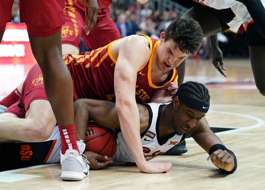 Oklahoma State Cowboys forward Cameron McGriff (bottom) and Iowa State Cyclones forward Michael Jacobson (top) fight for a loose ball during the first half at Sprint Center on March 11, 2020.