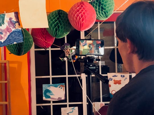 """Morgan McGrew sets up a scene for the stop-motion recreation of """"Toy Story 3"""" that he spent years and countless hours creating with his brother Mason. The film was released on YouTube at the end of January."""