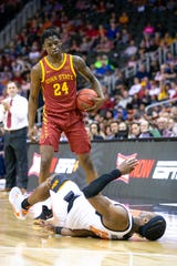 Iowa State Cyclones guard Terrence Lewis (24) stands over Oklahoma State Cowboys forward Cameron McGriff (12) after a collision during the first half at Sprint Center on March 11, 2020.