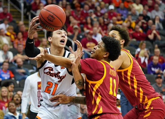 Oklahoma State Cowboys guard Lindy Waters III (21) loses control of the ball against Iowa State Cyclones guard Prentiss NixonÊ (11) and forward George Conditt IV (4) during the first half at Sprint Center on March 11, 2020.
