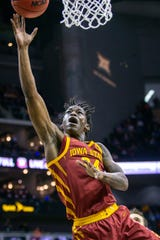 Iowa State Cyclones guard Terrence Lewis (24) shoots against the Oklahoma State Cowboys during the first half at Sprint Center on March 11, 2020.