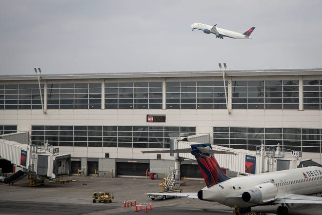 A Delta aircraft takes off near the McNamara Terminal at Detroit Metro Airport in Romulus, Thursday, March 12, 2020.