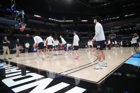 The Michigan Wolverines and Rutgers Scarlet Knights warm up before their first round Big Ten tournament game at Bankers Life Fieldhouse in Indianapolis, Indiana was canceled due to the Coronavirus Pandemic Thursday, March 12, 2020.