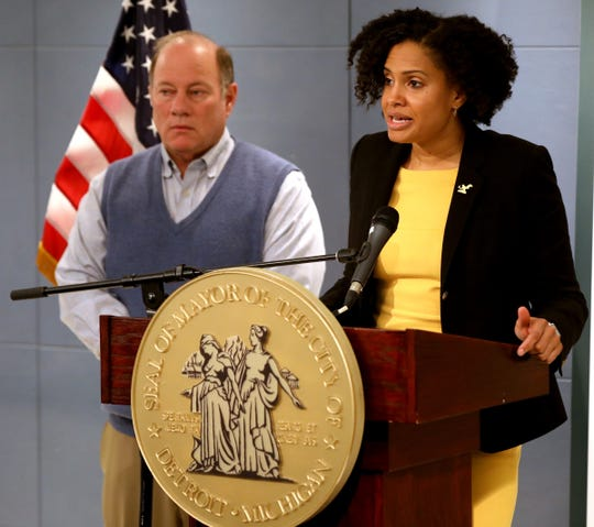 Denise Fair the chief public health officer talks with the media as Mayor Mike Duggan looks on about the Coronavirus and the Detroit Health Department's recommendation for response to the growing problem.The press conference was held at the mayor's office at City Hall in Detroit, Michigan on Thursday, March 12, 2020.