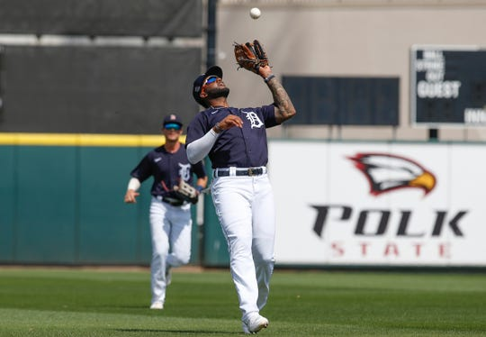 Mar 12, 2020; Lakeland, Florida, USA; Detroit Tigers left fielder Niko Goodrum (28) makes a catch during the fifth inning against the Atlanta Braves at Publix Field at Joker Marchant Stadium. Mandatory Credit: Reinhold Matay-USA TODAY Sports
