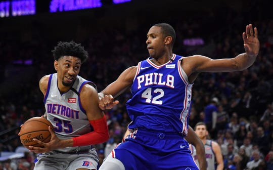 Detroit Pistons forward Christian Wood drives to the basket against Philadelphia 76ers forward Al Horford during the second quarter at Wells Fargo Center in Philadelphia, March 11, 2020.