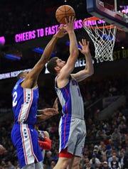 Detroit Pistons guard Sviatoslav Mykhailiuk drives to the basket against Philadelphia 76ers forward Al Horford during the second quarter at Wells Fargo Center in Philadelphia, March 11, 2020.