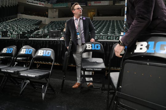 Staff member Joseph Hamata removes seating after the Michigan Wolverines vs. Rutgers Scarlet Knights first round Big Ten tournament game at Bankers Life Fieldhouse in Indianapolis was canceled due to the Coronavirus Pandemic on Thursday, March 12, 2020.