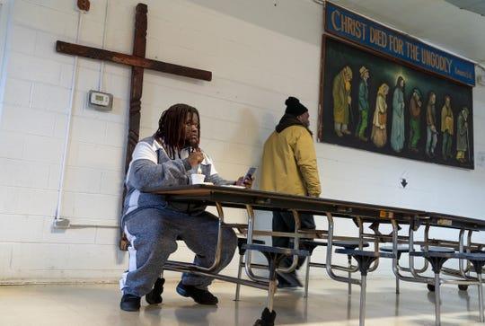 Juan Tripp of Detroit eats a meal at Detroit Rescue Mission Ministries in Detroit on Thursday, March 12, 2020.