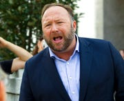 In this Sept. 5, 2018, file photo conspiracy theorist Alex Jones speaks outside of Capitol Hill in Washington.