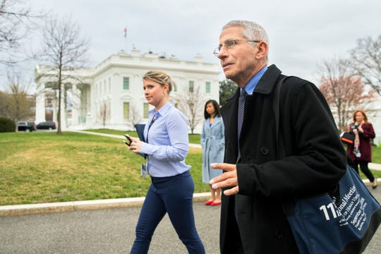 Director of the National Institute of Allergy and Infectious Diseases at the National Institutes of Health Dr. Anthony Fauci walks on the North Lawn outside the West Wing at the White House, Thursday in Washington.