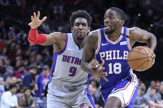 Philadelphia 76ers' Shake Milton drives on Detroit Pistons' Langston Galloway  during the second quarter Wednesday. It will be the last Pistons game until further notice.
