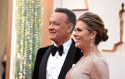 Tom Hanks, left, and Rita Wilson arrive at the Oscars on Sunday, Feb. 9, 2020, at the Dolby Theatre in Los Angeles.