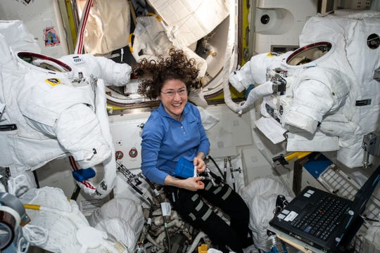 Expedition 60 Flight Engineer Christina Koch of NASA works inside the Quest joint airlock cleaning U.S. spacesuit cooling loops and replacing spacesuit components.