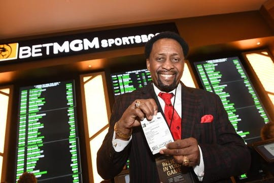 Detroit boxer Thomas Hearns shows off his ticket at the MGM Grand Casino in Detroit as sports betting in Michigan became legal on Wednesday.