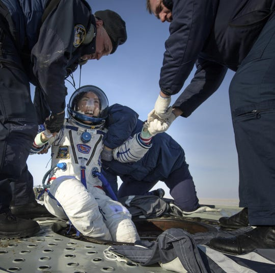 Christina Koch is helped out of the Soyuz MS-13 spacecraft just minutes after she landed in a remote area near the town of Zhezkazgan, Kazakhstan on Feb. 6, 2020.