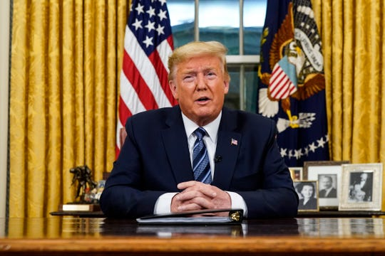 President Donald Trump speaks in an address to the nation from the Oval Office at the White House about the coronavirus Wednesday in Washington.