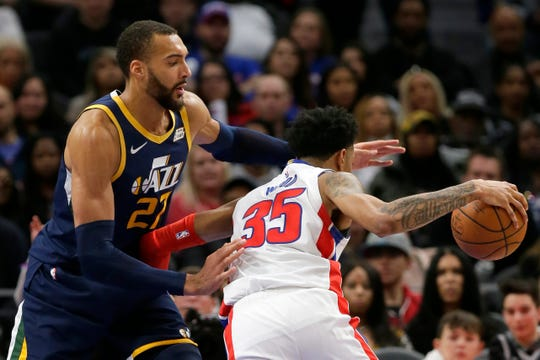 Utah Jazz center Rudy Gobert (27) guards Detroit Pistons forward Christian Wood (35) during the second half of an NBA basketball game Saturday in Detroit.