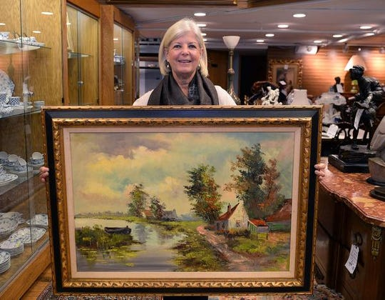 Judith Bueno with her painting.