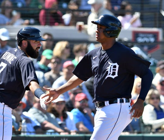 The Tigers' Jonathan Schoop (right), shown here in a game last month, clubbed his first home run of the spring Thursday.