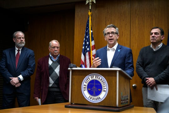 """Evansville and Vanderburgh County officials, including EVSC Superintendent David Smith, from left, Health Officer Dr. Robert K. Spear, Mayor Lloyd Winnecke and County Commissioner Jeff Hatfield, gather for a press conference at Evansville's Civic Center to announce their plans to comply with an executive order from Gov. Eric Holcomb that prohibits """"non-essential"""" gatherings of more than 250 people starting at 5 p.m. Friday, March 13, 2020. This is in response to the global outbreak of COVID-19."""
