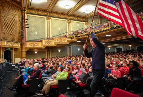 """Mimicking the Olympics, Maestro Alfred Savia brings the flag to the stage as over 5,000 students from throughout the Tri-State help celebrate Beethoven's 250th birthday with the Evansville Philharmonic Orchestra's """"Helen M. McKinney Young People's Concerts"""" at Evansville's Victory Theatre Thursday, March 12, 2020."""
