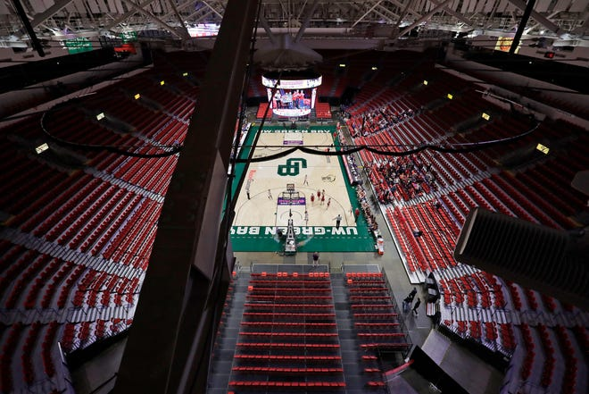 The stands are mostly empty as Arcadia High School plays against Platteville High School during their Division 3 semifinal game at the WIAA girls state basketball tournament Thursday at the Resch Center in Ashwaubenon.