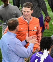 Clemson Head Coach Dabo Swinney talks with defensive coordinator Brent Venables during Clemson Pro Day at the Poe Indoor Facility in Clemson Thursday, March 12, 2020.