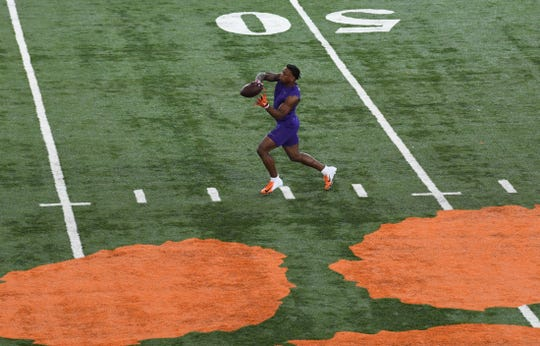 Safety K'Von Wallace catches a ball during Clemson Pro Day at the Poe Indoor Facility in Clemson Thursday, March 12, 2020.