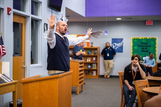 Kyle Bishop, Carolina High School's new head coach of the football team addresses students Thursday, March 12, 2020.