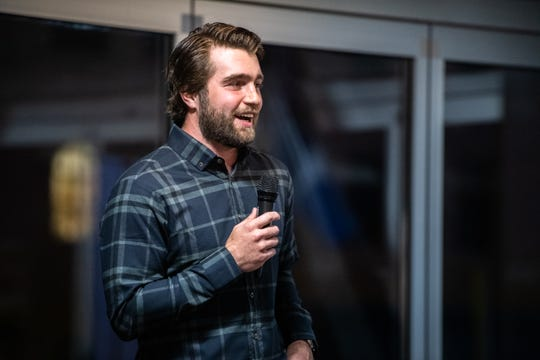 Bretton Cameron, a former pro hockey player from Alberta Canada, speaks at the Greenville News storytellers event at Fluor Field, Tuesday, March 10, 2020.
