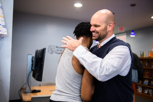 Kyle Bishop, Carolina High School's new head coach of the football team shakes students' hands after delivering a statement Thursday, March 12, 2020.