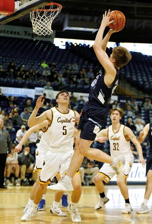 Great Falls High's Drew Wyman connects with a jumper past Helena Capital's Trevor Swanson during Thursday's Boys State AA Basketball Tournament at the Brick Breeden Fieldhouse in Bozeman.
