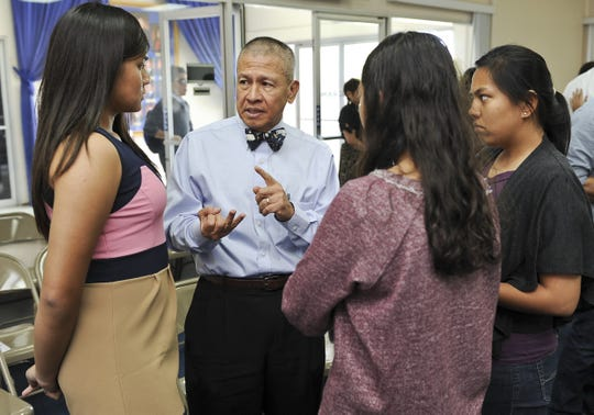 """The late Dr. Walter Chris Perez, sporting his characteristic bow tie, speaks with a group of student interns during a meeting at the Guam Legislature in this 2013 file photo. The Make-A-Wish Foundation is holding """"Bow Ties For Wishes"""" from 6 to 9 p.m. March 18 at Triple J in Tamuning."""