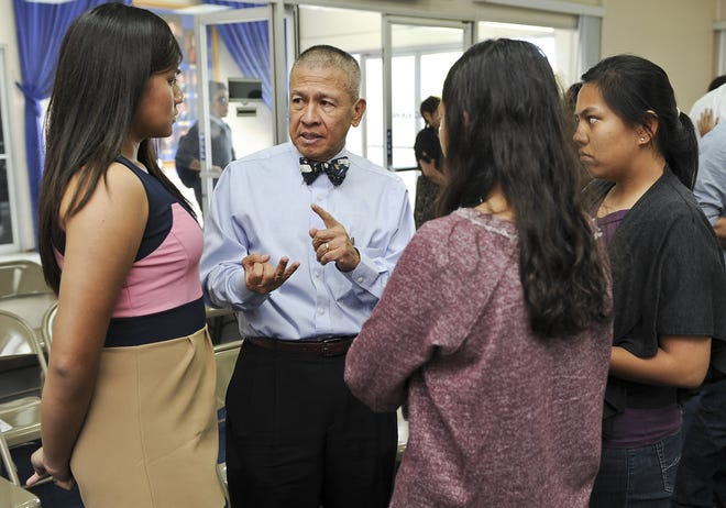 "The late Dr. Walter Chris Perez, sporting his characteristic bow tie, speaks with a group of student interns during a meeting at the Guam Legislature in this 2013 file photo. The Make-A-Wish Foundation is holding ""Bow Ties For Wishes"" from 6 to 9 p.m. March 18 at Triple J in Tamuning."